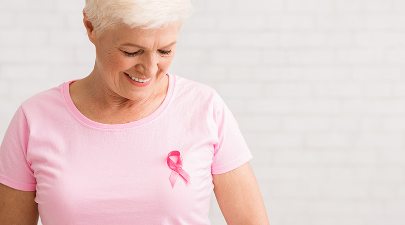 Woman checking her breast health